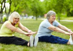 elderly-ladies-stretching-park-yoga (1)